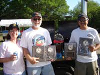 Suzan and Steve Mayberry and David Calvery display trophies won at a Muenster barbecue competition in 2007.