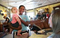 Server Chloe Smith talks with Sarah Hammond as she holds her baby, 6-month-old Harper Hammond.( Photos by Brad Loper  -  Staff Photographer )