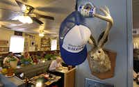 "Eclectic decor including a jackalope and a ""give me hat"" at The Mecca Restaurant in Dallas."