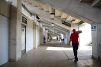 Groundskeeper Burt Jones, 71, carries cans of soda through the restrooms and concessions area, which will be expanded, at Mesquite Memorial Stadium on March 5, 2014. Mesquite ISD recently approved $11 million worth of renovations to the stadium, including an elevator, that should be ready by the start of the 2015 football season.(Rose Baca - neighborsgo staff photographer)