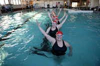 Pam Fojtik (front) and coach Rosita Ray-Hoyes (second from front) rehearse a routine with the rest of the Mermaids, a senior synchronized swimming team, at the McKinney Senior Recreation Center on Nov. 26. The group of 12, ages 63-78, started as a small water aerobics group in 2004 before transitioning to a synchronized swimming team, with rehearsals twice a week.( ROSE BACA )