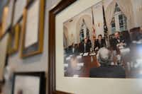 A photo, which hangs in Merrie Spaeth's office on April 4 in Dallas, shows Spaeth sitting behind President Ronald Reagan during a meeting at the White House. In 1983, President Ronald Reagan appointed her as director of media relations at the White House.( Rose Baca  -  neighborsgo staff photographer )