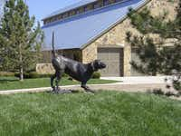 A sculpture of T. Boone Pickens' favorite hunting dog stands at the entrace to the kennels at his Mesa Vista Ranch in the Texas Panhandle.