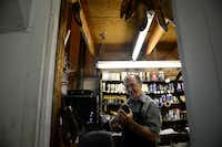Kenneth Burks repairs a shoe in the back room of his shop, Messina Shoe Repair, in Farmers Branch. Kenneth Burks and his wife, Nancy, have owned and operated the shop since 1964.Rose Baca - neighborsgo staff photographer