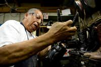 Raul Torres repairs the sole of a boot in the back room of Messina Shoe Repair.Rose Baca - neighborsgo staff photographer