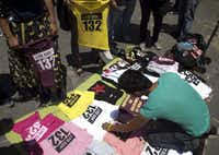 A vendor set out #YoSoy132 shirts for sale during a rally Wednesday in Mexico City. Some have likened the youth movement to last year's Arab Spring uprisings in the Middle East.