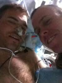 Travis Mills (left) and his brother-in-law, Josh Buck, at a military hospital in Landstuhl, Germany, where Mills was taken after he lost his arms and legs in an IED explosion in Afghanistan on April 10. Buck, also a soldier, accompanied Mills to Walter Reed National Military Medical Center in Bethesday, Md., where Mills was to reunite with his wife and their daughter on April 17.