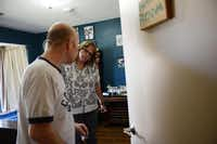 Franklin talks to Johnston, habilitative coordinator for Mosaic Dallas, in his bedroom. The walls of his room are painted Dallas Cowboys blue and covered with photos, posters and paintings.( ROSE BACA/neighborsgo staff photographer )