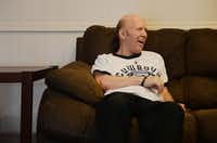Franklin reacts while talking to Johnston in his Richardson home. He carpools each weekday to work at Mosaic's dayhab program in Carrollton.ROSE BACA/neighborsgo staff photographer