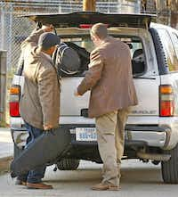 Dallas police loaded items Wednesday from a Cedars neighborhood duplex where Nick and Vanessa Pitofsky were found dead. Police believe the couple had been dead for days.Tom Fox  -  Staff Photographer