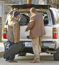 Dallas police loaded items Wednesday from a Cedars neighborhood duplex where Nick and Vanessa Pitofsky were found dead. Police believe the couple had been dead for days.( Tom Fox  -  Staff Photographer )