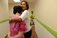 Volunteer Kathy Wright hugs a student in her health and fitness class at My Possibilities.