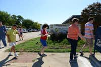 Students in the health and fitness class go for a walk around the My Possibilities facility.