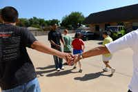 Students and volunteers in the health and fitness class go for a walk around the My Possibilities facility, a day program for adults with disabilities. The facility provides assistance for about 170 adults per day, but a month-and-a-half after moving to their current Plano facility, the program is looking for more space.