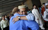 Rais Bhuiyan embraces David Hultsch, who donated a car to Bhuiyan to help him recover after he was shot.