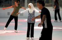 Nia MacKay (center) takes to the ice at the Galleria in her hijab, which she started wearing before 9/11 but which caused her problems at work after 9/11.