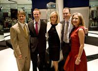 From left: Clark Hunt, Dan Hunt, mother Norma Hunt, Lamar Hunt Jr. and Sharron Hunt pose in front of the Lombardi Trophy at the Lamar Hunt Super Bowl Gallery at the NFL Hall of Fame in Canton, Ohio.