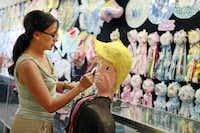 Co-owner Elvie de la Fuente of ABC Party Headquarters on West Davis Street in north Oak Cliff decorates a Donald Trump piñata at her family's business. The shop sold its first one this week for $65.( Ben Torres  -  Special Contributor )