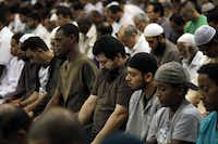 Julio Cesar Molina (center), 42, participated in the nighttime daily prayer of Isha with other practicing muslims on July 17, 2014, at the Islamic Association of North Texas in Richardson.( Photo by Ben Torres  - special contributor)