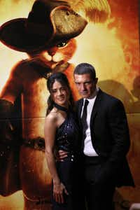 "Salma Hayek and Antonio Banderas during their red carpet walk at the Dallas premiere of ""Puss in Boots,"" on Oct. 18 in Grapevine."