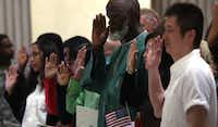 New American citizens were minted from 31 countries during a naturalization ceremony in May at New York's Federal Hall.Getty Images