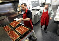 The kitchen is spacious and busy at the new Pizza Hut headquarters off  Corporate Drive in Plano on Tuesday.
