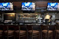 The new Bennigan's in Lake Worth features lots of flat-screen TVs in its bar area.