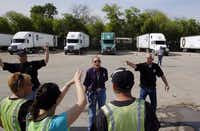 From left: Instructor David Ables, Connie Ward and director Greg Peace talk to students during a training session at FFE Driver Academy in Fort Worth. FFE typically has about 20 students in driving classes at its school.