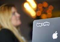 "Tech Wildcatters' Executive Director Molly Cain has a reminder on her laptop for ""More Doing, Less Talking."" (Tom Fox/The Dallas Morning News)"