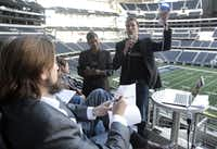Swapnil Bora (left) and Corey Egan made the pitch for their LED lights at Cowboys Stadium in Arlington in a competition organized by Startup Texas in early December.