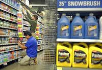 Jonathan Amador (front) and Zackery Middleton fine-tune the household goods section as they get ready for the opening of the Edgewood Wal-Mart.(Tom Fox - Staff Photographer)
