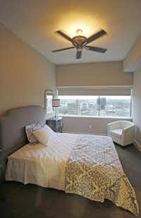 A bedroom in a luxury apartment at One Dallas Center, 350 North St. Paul St. in Dallas, photographed on Wednesday, October 8, 2014.(Louis DeLuca - Staff Photographer)