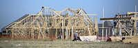 Construction workers build houses in the Windsong Ranch development Wednesday June 10, 2015 Prosper, Texas.G.J. McCarthy  -  Staff Photographer