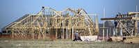 Construction workers build houses in the Windsong Ranch development Wednesday June 10, 2015 Prosper, Texas.( G.J. McCarthy  -  Staff Photographer )