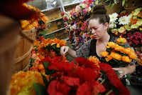 Lindsay Vonhagel of Denton shops for artificial flowers at At Home.( Andy Jacobsohn  -  Staff Photographer )