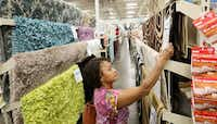 Martha Smith of Carrollton shops for rugs at the At Home store in Lewisville. At Home stores stock 50,000 items, including more than 500 area rugs. Rug prices range from $3 to $500.( Andy Jacobsohn  -  Staff Photographer )