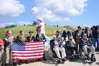 Joe Geary (far right), and other veterans pose for a group photo at the Utah Beach American Memorial June 2014 in France. Geary is a WWII veteran and former Dallas City Councilman.