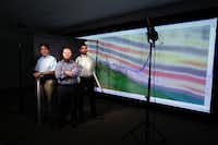 Geologists Hector Bello, left, Doug Portis, center, and Neil Basu at Pioneer Natural Resources pose in the company's 3-D Visualization Room.