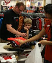 Collin Willits, 7, and his father, Joel Willits, bought clothes Sunday at J.C. Penney in Stonebriar Centre in Frisco.