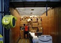 Michael Lucka packs up a semi trailer at the Amazon.com fulfillment center in Coppell, Texas August 12, 2015. (Nathan Hunsinger/The Dallas Morning News)