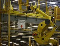 The Robo-Stow moves pallets from level to level at the Amazon.com fulfillment center in Coppell, Texas August 12, 2015. (Nathan Hunsinger/The Dallas Morning News)