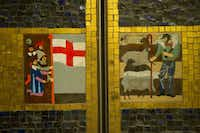Elevator doors on the first floor of the Continental apartment building are decorated with restored original tile.