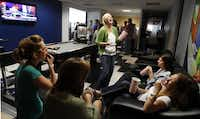 """lsey Vross, center, jokes with her co-workers at The Marketing Arm in their weekly """"3 O'clock Pop."""""""