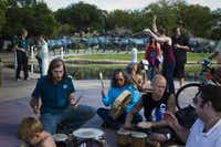 """Occupy Dallas protesters have occasional drum circles in Pioneer Plaza. The loose-knit group doesn't have a single message or official leaders, but it has rules, such as no drugs or alcohol in the park. """"Everyone is here because they want to see a change,"""" one protester said."""