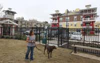 Donna Snyder takes Koko to the dog park at Hebron 121 Station, a convenience for pet lovers.