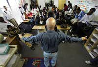Former prison inmate Jimmy Johnson addresses a group of students Dec. 15, 2010, at the Dallas Can Academy in South Dallas. Mr. Johnson, who at one time was deep into drugs, has now turned his life around through dedication and help from Crossroads Community Services.
