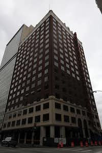 The 1700 Commerce Street office building will be converted to a 176-room Hampton Inn hotel. (G.J. McCarthy/The Dallas Morning News)( G.J. McCarthy  -  The Dallas Morning News )