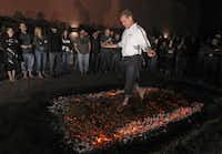 Gene Gray was first to walk across 1,200 degree coals at the Marriott last February.