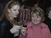 Sherrie Greggerson and Sue Grindinger of Flower Mound sample a red wine at Homestead Winery.