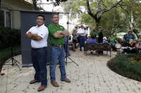 Ronnie Contreras, left, and Alvin Cozby, employees of Scott+Reid General Contractors, Inc. attend a production meeting with co-workers at Brad Reid's home in Dallas.